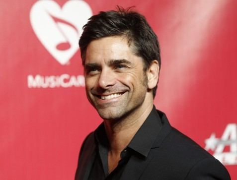 John Stamos Red Background Reuters