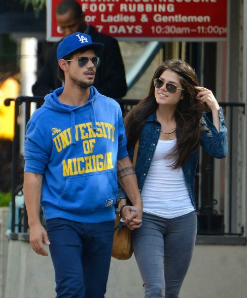 Taylor Lautner Marie Avgeropoulos Holding Hands Soho Abe Fd And Taylor Lautner